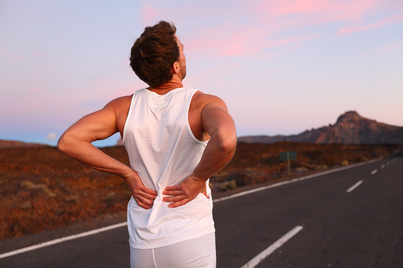 Back pain - Athletic running man with injury